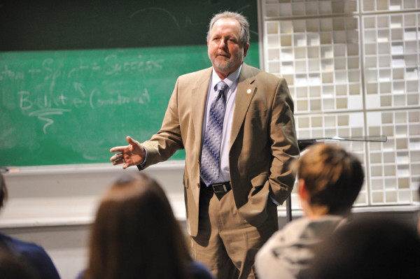 David Mills, professor of music, teaches a class on leadership for the UConn Marching Band. (Peter Morenus/UConn Photo)